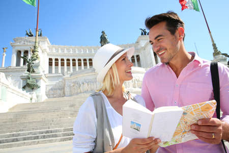 emmanuel: Couple reading map by the monument of Victor Emmanuel II