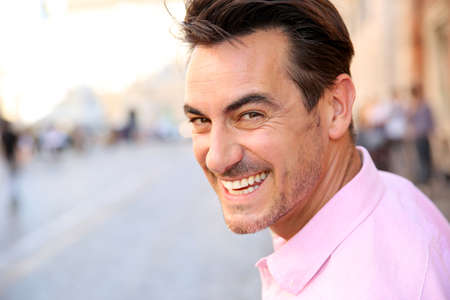 old people smiling: Closeup of handsome guy wearing pink shirt