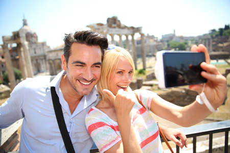 europe closeup: Couple taking picture by the Roman Forum