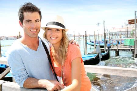 Tourists standing on bridge in Venice photo