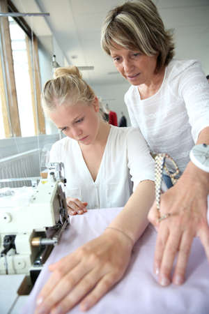 dressmaking: Student with teacher in dressmaking class