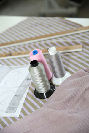 dressmaking: Closeup of dressmaking tools set on table Stock Photo
