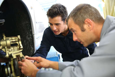 vocational: Teacher and student in auto mechanics training class Stock Photo
