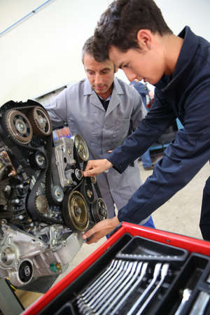Teacher and student in auto mechanics training class photo