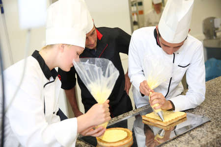 Young people in pastry training course Banco de Imagens