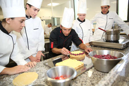 cooks: Students with teacher in pastry training course Stock Photo