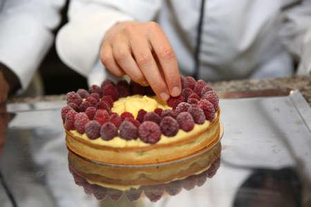 craftsmanship: Closeup on raspberry cake being made