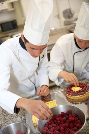 french pastry: Students in training class making French pastry