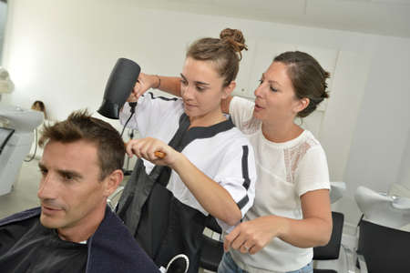 Hairstyle training class in beauty salon photo