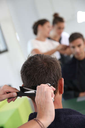 Closeup of haircut in hairdressing school photo