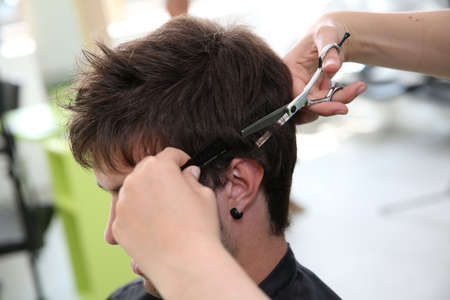 scissors hair: Closeup of hairdresser cutting hair to customer