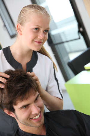 Portrait of hairdressing student girl in hair salon photo
