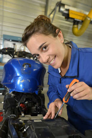 Student girl in motorbike mechanics photo