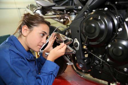 Student girl in motorbike mechanics