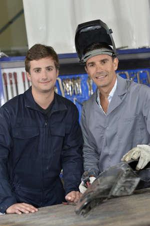 maching: Trainee with instructor using welding machine
