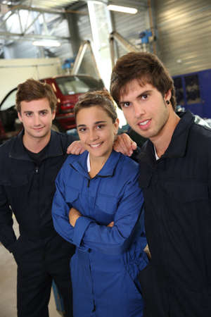 coachwork: Group of students in coachbuidling standing in garage