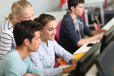 computer class: Group of students in computers room