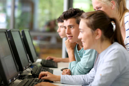 computer classes: Students in class working on desktop computer Stock Photo