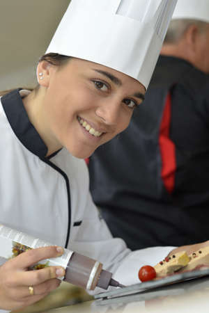 caterer: Young caterer preparing foire gras dish