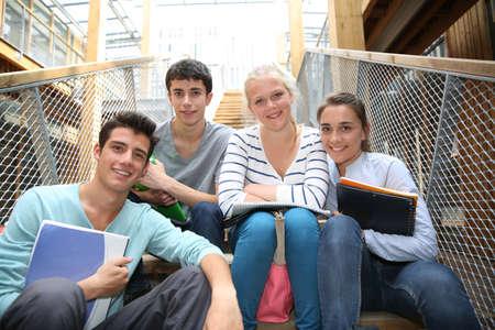 highschool students: Group of cheerful students in school yard