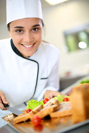 Portrait of beautiful young caterer preparing food tray Reklamní fotografie