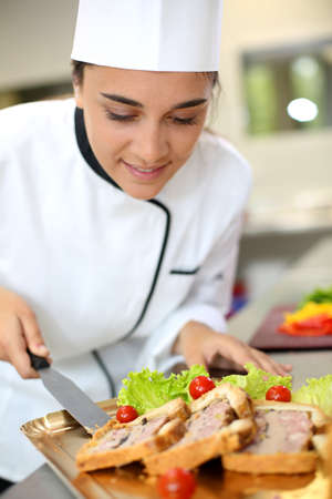 caterer: Portrait of beautiful young caterer preparing food tray Stock Photo
