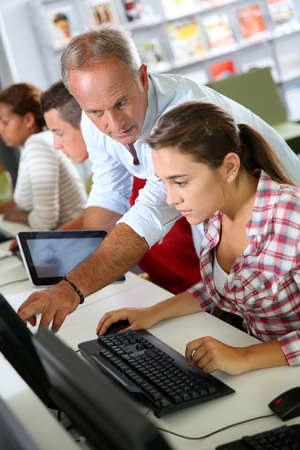 Instructor in training class with students Stock Photo