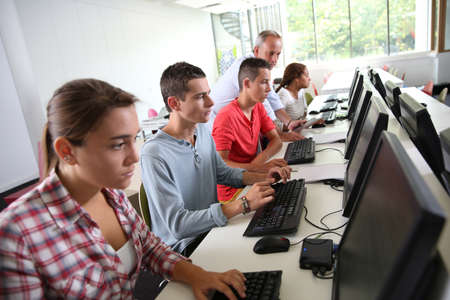 classroom training: Group of young people in computing class