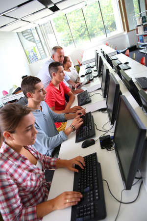 Group of young people in computing class photo