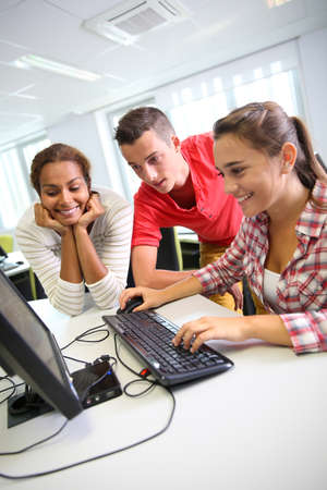 Group of students in computers laboratory photo
