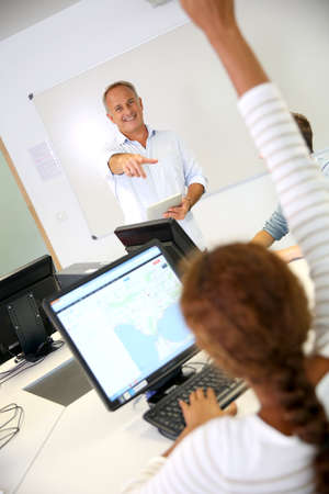 Business school teacher doing lecture on whiteboard photo