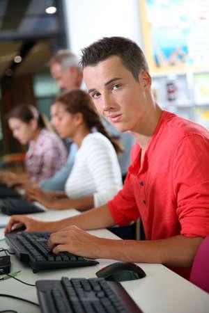 College student working on desktop computer photo