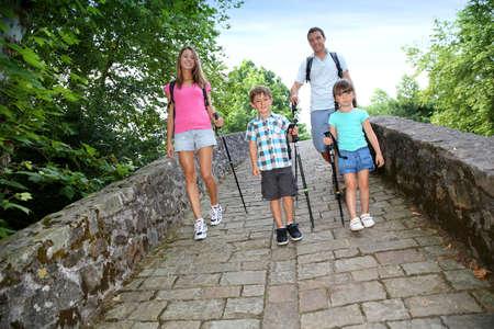 rambling: Family on a rambling journey crossing roman bridge