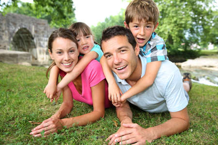 grownups: Portrait of parents with kids on their back Stock Photo
