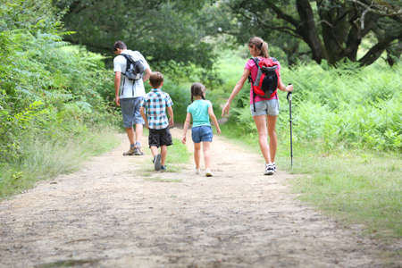 hiking stick: Back view of family on a trekking day in countryside Stock Photo