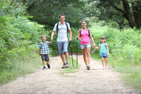 Family on a trekking day in countryside photo