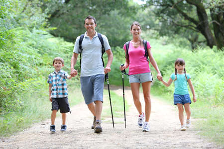 hiking stick: Family on a trekking day in countryside