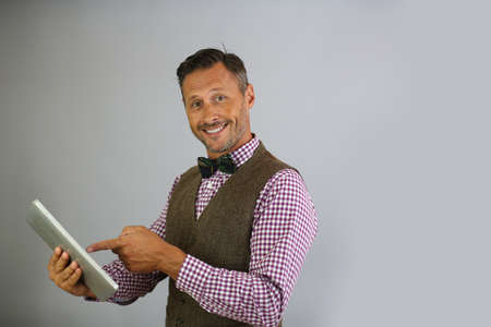 websurfing: Trendy guy holding tablet on white background