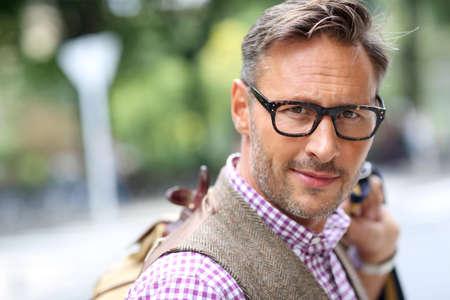 eyewear: Trendy smiling guy traveling with bag