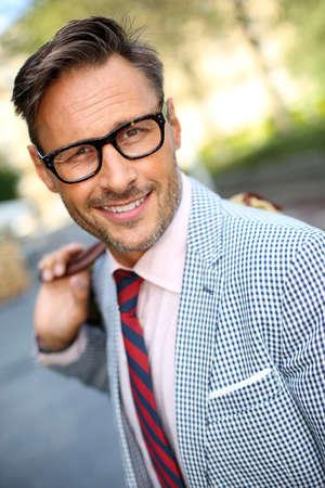 40 years old man: Trendy smiling guy walking in the street