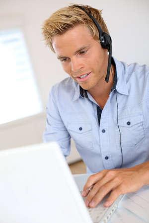 teleoperator: Smiling attractive customer service representative