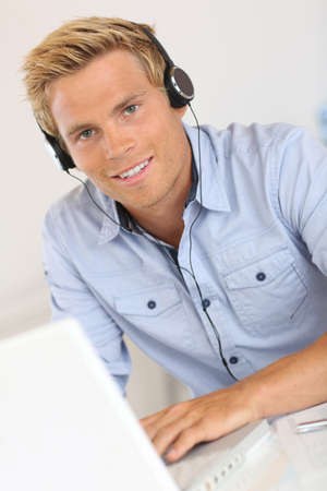 Salesman with headset in conference call photo