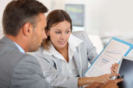 investor: Young woman presenting business plan to financial investor Stock Photo