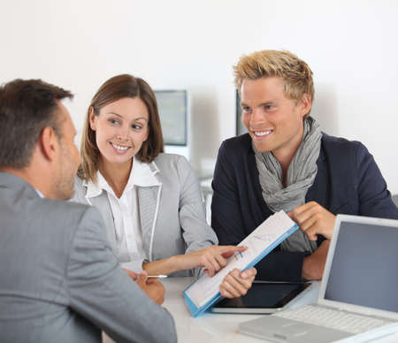 investor: Business partners presenting business plan to investor