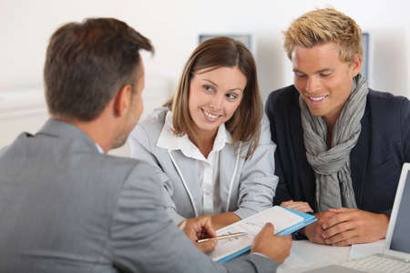 Business partners presenting business plan to investor Stock Photo - 22032104