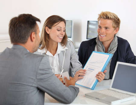 Business partners presenting business plan to investor Stock Photo - 22032105