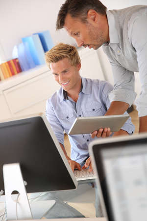 Manager with employee working in office Stock Photo - 22032132