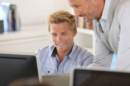 Manager with employee working in office Stock Photo - 22032135