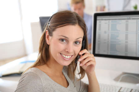 telephone saleswoman: Beautiful smiling teleoperator with headset on