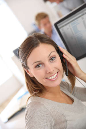 teleoperator: Beautiful smiling teleoperator with headset on